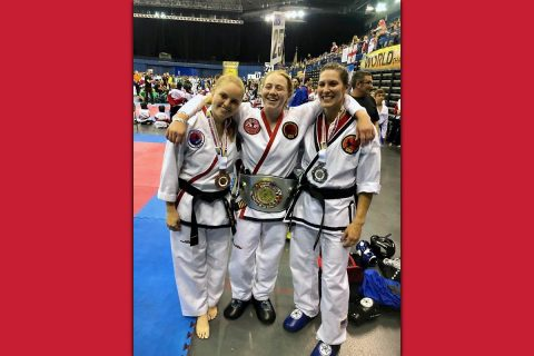 Austin Peay State University senior Allie Honeycutt, center, wears her gold belt with her teammates last month at the Tae Kwon-Do International World Championships in Birmingham, England.