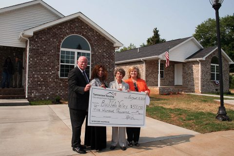 Tennessee Housing Development Agency presented a $500,000 check toward the construction of these homes during the ceremony to Buffalo Valley.