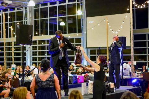Handbags For Hope host Jimmy Terry Jr. and Auctioneer Shane McCarrell during live auction. (Jennifer Mead)