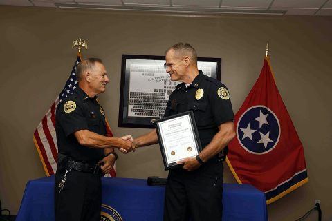 Retiring Clarksville Police Department Deputy Chief Charles F. Gray (left) shakes hands with Chief of Police Al Ansley (right).