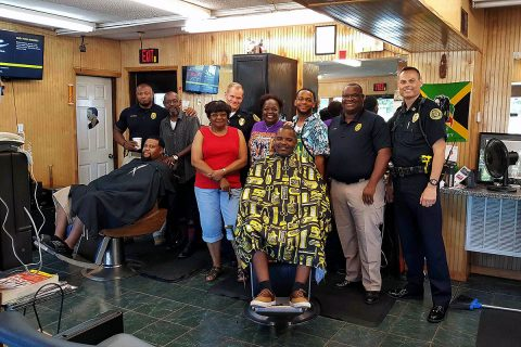 "Clarksville Police Department visit with people at Keesee Barbershop during their third ""Chat and a Cut"" community outreach event."