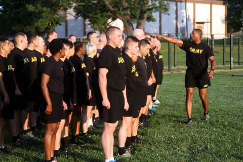 Master Sgt. Daarius Jackson, Office of the Staff Judge Advocate, Headquarters and Headquarters Battalion, 101st Airborne Division (Air Assault), divides a formation into 9 teams for circuit training behind Olive Gym on Fort Campbell, Kentucky, July 27. Jackson led the physical training and has been a Master Fitness Instructor in the Army for six years. (Pfc. Lynnwood Thomas, 40th Public Affairs Detachment)