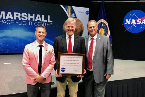 Austin Peay State University representatives Dr. Donald Sudbrink, center, professor and chair of the APSU Department of Agriculture; Bill Persinger, right, executive director for Public Relations & Marketing; and Bryan Gaither, lab manager for the Department of Physics, Engineering and Astronomy, accepted the award with other members of the Marshall Space Flight Center Solar Eclipse Team on August 22nd in Huntsville, AL.
