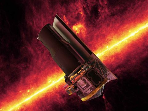 This image shows an artist's impression of the Spitzer Space Telescope. The background shows an infrared image from Spitzer of the plane of the Milky Way galaxy. (NASA/JPL)