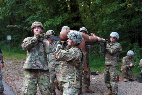 Reserve Officer Training Corps and United States Military Academy cadets perform a litter carry with a simulated casualty during a six-lane physical training course Aug. 8 on Fort Campbell, Kentucky. (Pfc. Lynnwood Thomas, 40th Public Affairs Detachment)