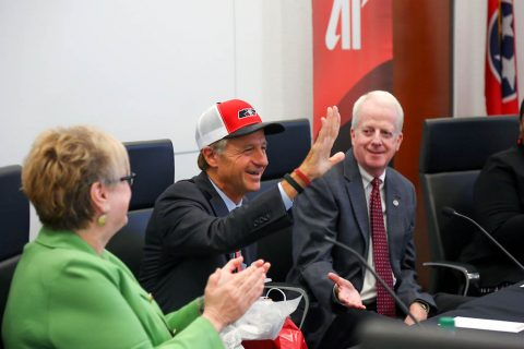Austin Peay State University President Alisa White and Board Chair Mike O'Malley present Tennessee Governor Bill Haslam with an APSU hat.