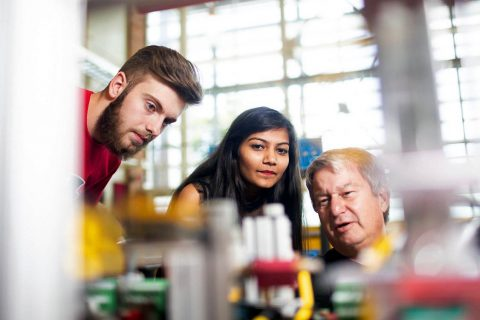 Joshua Schlensker and Ushma Patel, both of Clarksville, and APSU lab technician Timothy Daniel examine the new mechatronics equipment.