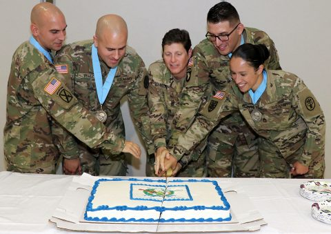 Command Sgt. Maj. Michele Johnson, (center) assigned to the 531st Field Hospital Center, cuts the celebratory cake, Sept. 7, with newly inducted Sgt. Audie Murphy Club members (left to right) Sgt. 1st Class James Rowland, 101st Airborne Division Artillery Brigade, Staff Sgt. Javier Velez, Fort Campbell Dental Health Activity, Sgt. 1st Class Gregory Rios and Sgt. 1st Class Victoria Romero, both assigned to Blanchfield Army Community Hospital. (U.S. Army photo by Maria Yager)