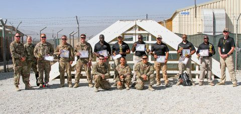 Contractors, Soldiers and Department of the Army Civilians congratulate contestants of the K9 Competition that occurred here on Bagram Airfield, Afghanistan. The K9 competition, held September 16, 2018, consisted of four events: detection, obedience, agility and controlled aggression. In each event, the working dog teams were evaluated on their expedience to complete the task, their accuracy, their focus and their obedience to their handler's commands. (Staff Sgt. Caitlyn Byrne, 101st Sustainment Brigade Public Affairs)