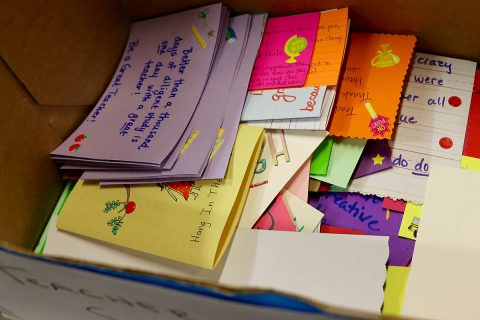 Team members from Blanchfield Army Community Hospital's Department of Behavioral Health wrote notes of appreciation for local teachers. The notes and school supplies donated by department staff were delivered Sept. 6 to the Clarksville-Montgomery County Education Foundation Teacher Warehouse, which allows local teachers to get limited free supplies for their classroom. (Maria Yager)