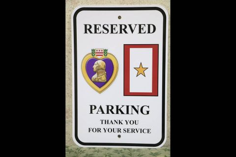 New reserved parking sign for Purple Heart recipients and Gold Star families.