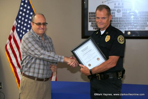 Clarksville Police Lt. Steve Warren receiving his Certificate of Retirement from Chief Al Ansley.
