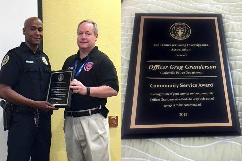 Clarksville Police Officer Greg Granderson receiving Community Service Award.