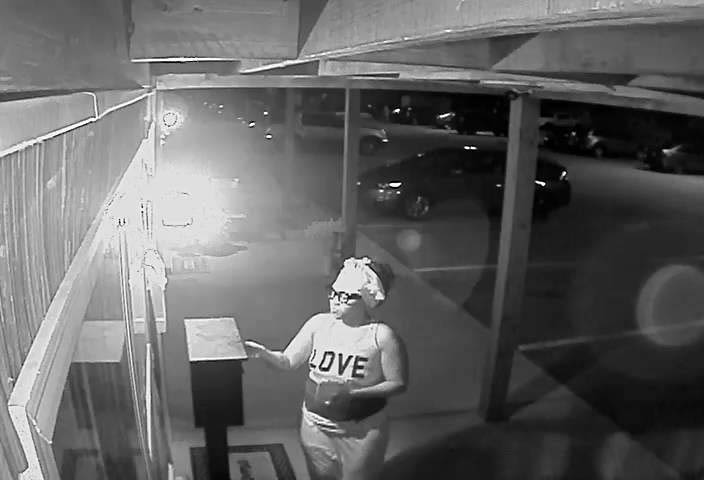 Woman in this photo can be seen breaking into the Money Drop Box.
