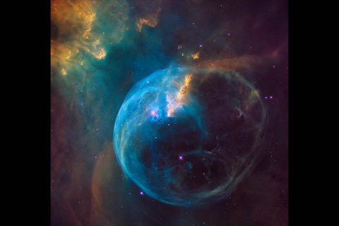 A zoom into the Hubble Space Telescope photograph of an enormous, balloon-like bubble being blown into space by a super-hot, massive star. Astronomers trained the iconic telescope on this colorful feature, called the Bubble Nebula, or NGC 7635. (NASA, ESA, and the Hubble Heritage Team (STScI/AURA), F. Summers, G. Bacon, Z. Levay, and L. Frattare (Viz 3D Team, STScI))