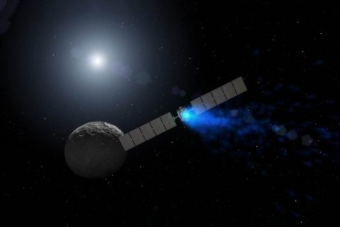 Artist's concept of NASA's Dawn spacecraft orbiting dwarf planet Ceres. (NASA/JPL-Caltech/UCLA/MPS/DLR/IDA)