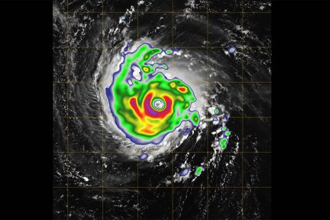 This image combines the TEMPEST-D (Temporal Experiment for Storms and Tropical Systems Demonstration) data with a visual image of the storm from NOAA's GOES (Geoweather Operational Environmental Satellite) weather satellite. The brightly colored image taken by the small, experimental satellite TEMPEST-D captures Hurricane Florence over the Atlantic Ocean. The colors reveal the eye of the storm, surrounded by heavy rain. (NASA/NOAA/Naval Research Laboratory Monterey/JPL-Caltech)
