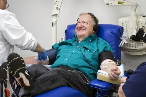Dennis Clapper donates platelets at a Blood Donation Center. He started giving whole blood in the 1960s and switched to giving platelets in the late 1970s. (Amanda Romney, American Red Cross)