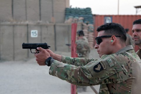 "German army Maj. Andreas Mehlhron, a field artillery officer, and officer in charge of the ""Schutzenschnur"" event, coaches Spc. Anthony Addcock, a motor transportation specialist with the 101st Resolute Support Sustainment Brigade, while he fires the Koch P8 Pistol at Maholic Range on Bagram Airfield, Afghanistan, September 14th, 2018. (Spc. Alexes Anderson, 101st Airborne Division (AA) Sustainment Brigade Public Affairs)"
