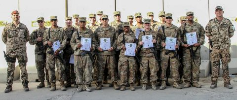 Soldiers of the 101st Resolute Support Sustainment Brigade proudly hold up their certificates of achievement after being recognized in an award ceremony for earning their German proficiency marksmanship badge on Bagram Airfield, Afghanistan, September 14th, 2018. (Spc. Alexes Anderson, 101st Airborne Division (AA) Sustainment Brigade Public Affairs)