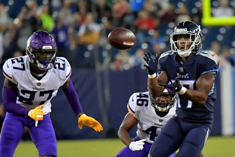 Tennessee Titans wide receiver Cameron Batson (17) catches a pass for a first down against Minnesota Vikings safety Jayron Kearse (27) and Vikings cornerback Trevon Mathis (46) during the second half at Nissan Stadium.(Jim Brown-USA TODAY Sports)