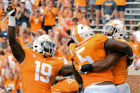 Tennessee Volunteers linebacker Darrell Taylor (19) and defensive lineman Kyle Phillips (5) celebrate with linebacker Darrin Kirkland Jr. (34) after he returned a interception for a touchdown against the East Tennessee State Buccaneers during the second quarter at Neyland Stadium. (Randy Sartin-USA TODAY Sports)