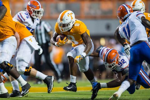 Tennessee Volunteers running back Ty Chandler (8) runs past Florida Gators defensive lineman Jabari Zuniga (92) in the first half of a game at Neyland Stadium. Bryan Lynn-USA TODAY Sports)