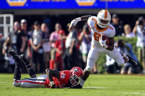 Tennessee Volunteers running back Ty Chandler (8) tries to escape a tackle by Georgia Bulldogs defensive back J.R. Reed (20) during the first half at Sanford Stadium. (Dale Zanine-USA TODAY Sports)