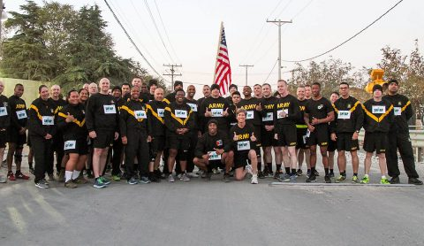 Soldiers of the 101st Resolute Support Sustainment Brigade gather around Col. Stephanie Barton, the Commander of the 101st Resolute Support Sustainment Brigade, and Command Sgt. Maj. Anthony McAdoo, the senior noncommissioned officer of the brigade, before participating in the 101st Lifeliner SHARP five kilometer run at Bagram Airfield, Afghanistan, Oct. 18, 2018. (1st Lt. Verniccia Ford, 101st Airborne Division (AA) Sustainment Brigade Public Affairs)