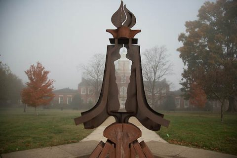 The Gateway, James Diehr's sculpture, reveals the Austin Peay State University campus' Browning Building on a foggy morning.