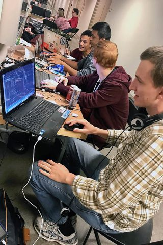 Austin Peay State University ACM members Daniel Blankenship, Aidan Murphy, Parth Patel and Zack Toupe work on their hack.