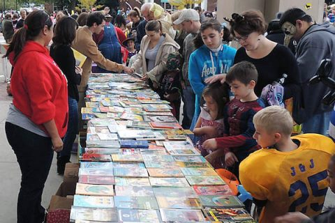 Children look through books at a previous Candy For the Mind event at Austin Peay State University.