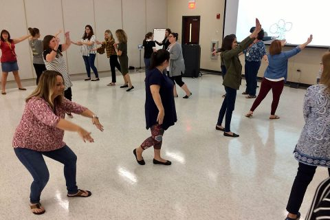 More than 20 local school teachers learned arts integration techniques to help them keep students engaged in learning the arts, such as dance, while learning other subjects, such as science. (Brian Dunn)