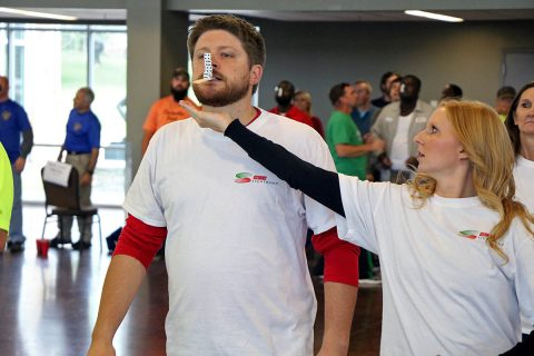 Members of CDE Lightband team Killa Watts, which took first place out of 12 six-member City of Clarksville employee teams, carefully walks across the Wilma Rudolph Event Center during the 2nd Annual United Way Field Day event October 16th, 2018.