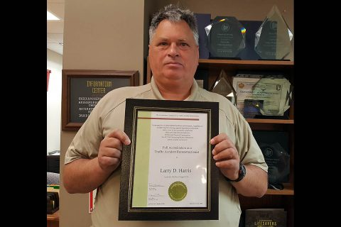 Clarksville Police Officer Larry Harris with his Traffic Accident Reconstructionist Accreditation.