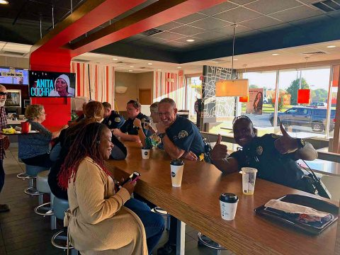 Clarksville Police Officers talking with McDonald's customers on National Coffee with a Cop Day.