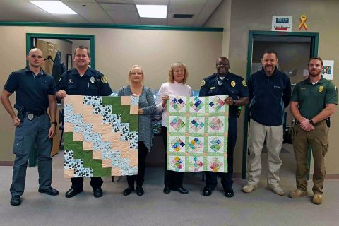 (L to R) Officer Westover, Officer Koziol, Eunice Conley, Donna Miller,  Lt Filmore, Detective Honholt, Detective Neagos. (Jim Knoll, CPD)