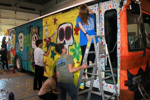 Clarksville Academy students gathered Monday to paint the Spooky Special, a Clarksville Transit System bus that will offer free rides on selected routes on October 30th-31st.