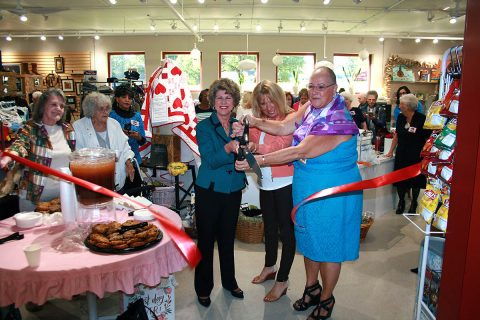 Clarksville Mayor Kim McMillan cuts a ribbon Friday to dedicate The Shoppe, a new thrift store at the Ajax Turner Senior Citizens.