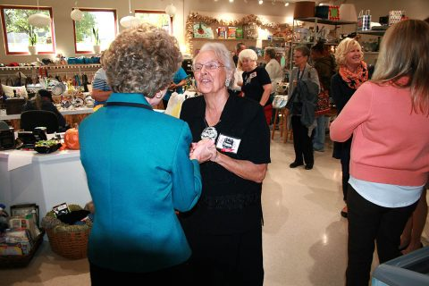 Clarksville Mayor Kim McMillan greets a member of the big crowd that gathered Friday day for the dedication of the new thrift store at the Ajax Turner Senior Citizen Center in Clarksville.
