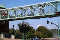 Workers from Pride Concrete LLC work Monday on the Clarksville Riverside Drive Pedestrian Overpass. The painting project, which will require some lane changes, is expected to begin October 15th.