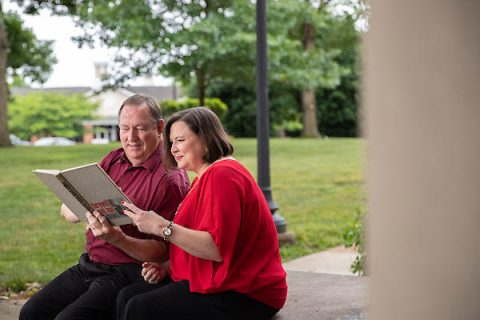 Alisha Jerles Horn and her father, Dr. Joe Jerles, look at an old Austin Peay yearbook.