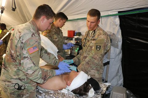 Soldiers from the 586th Field Hospital treat a simulated casualty in their new field hospital during a field exercise Oct. 16. The training was the first time the unit was able to break out its new 148-bed field hospital platform since transitioning from the 86th Combat Support Hospital to the Army's new modular field hospital platform. To date the Army has transitioned three of 10 combat support hospital's to the new design. (U.S. Army photo by Maria Yager)