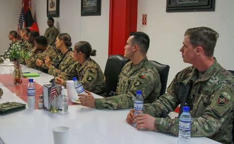 Junior Leadership Course candidates sit attentively during the JLC awards dinner, which signified the completion of the course, in the Dragon Dining Facility on Bagram Airfield, Afghanistan, Sept. 29, 2018. (SSG Caitlyn Byrne, 101st Sustainment Brigade PAO)