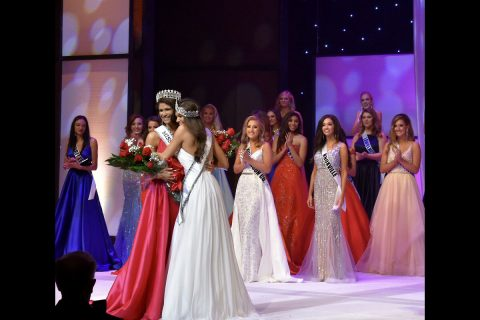 Newly crowned Miss Tennessee USA Savana Hodge and Miss Tennessee Teen USA Bailey Guy embrace after receiving their titles.