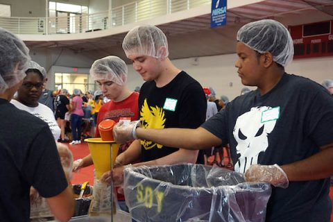 Austin Peay State University students pack meals during the Freshman Service Project.