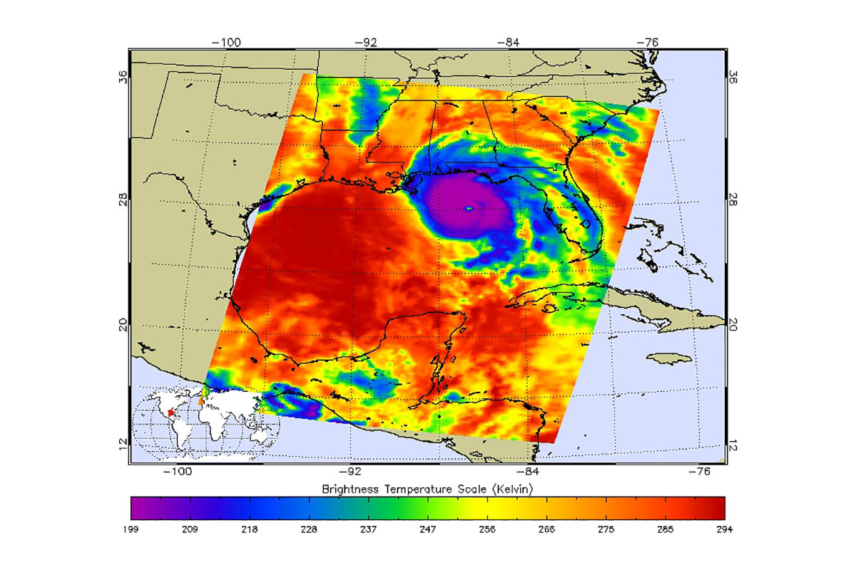 This AIRs image shows the temperature of clouds or the surface in and around Hurricane Michael. Purple represents very cold clouds, the much warmer eye is shown in green, and the red areas are warmer and mostly cloud-free. (NASA/JPL-Caltech)
