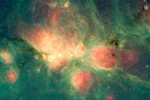 "The Cat's Paw Nebula, imaged here by NASA's Spitzer Space Telescope using the MIPS and IRAC instruments, is a star-forming region that lies inside the Milky Way Galaxy. New stars may heat up the surrounding gas, which can expand to form ""bubbles."" (NASA/JPL-Caltech)"