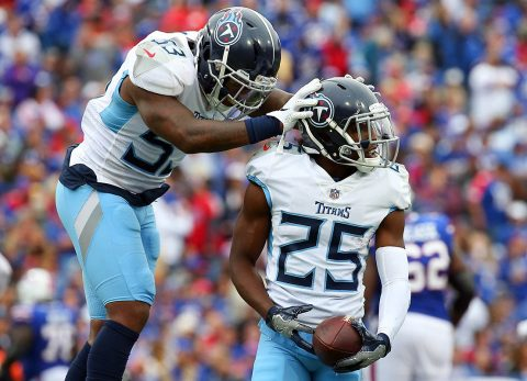 Tennessee Titans linebacker Daren Bates (53) reacts after an interception by cornerback Adoree' Jackson (25) against the Buffalo Bills during the fourth quarter at New Era Field. (Rich Barnes-USA TODAY Sports)