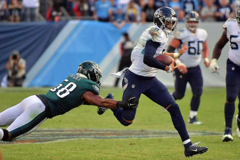 Philadelphia Eagles linebacker Jordan Hicks (58) reaches to tackle Tennessee Titans quarterback Marcus Mariota (8) during overtime at Nissan Stadium. (Jim Brown-USA TODAY Sports)